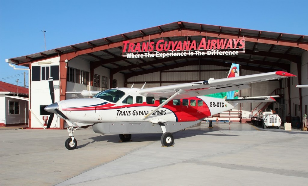 TGA plane in front of hangar